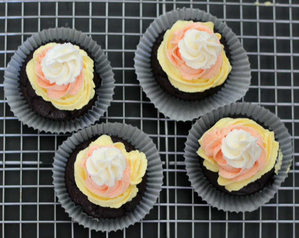 Add circle of low carb white buttercream frosting to cupcake