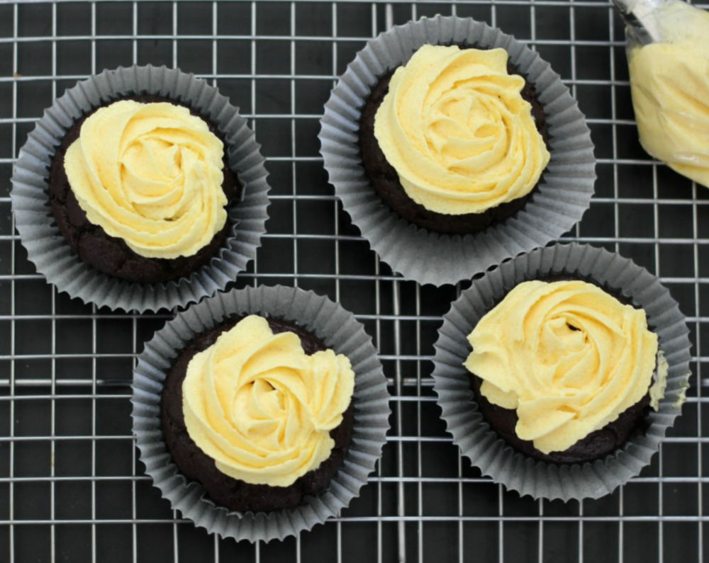 Add circle of yellow buttercream frosting to cupcake